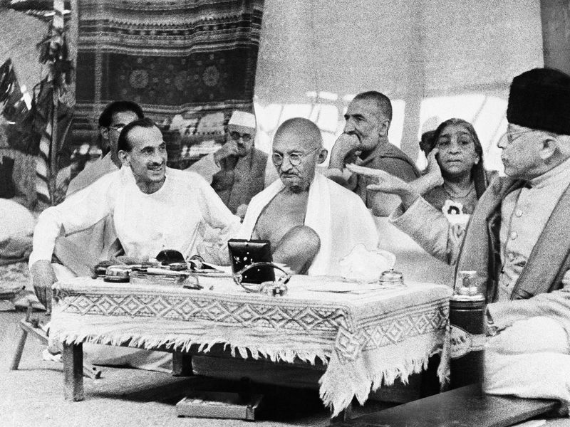 Mahatma Gandhi, center, confers with leaders of the All-India Congress Party, Aug. 1942 (Associated Press)
